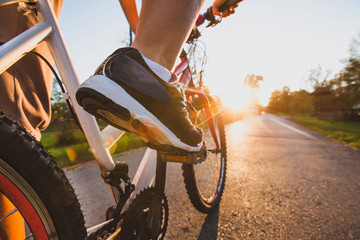 Poster de jardin Cyclisme cycling outdoors, close up of the feet on pedal