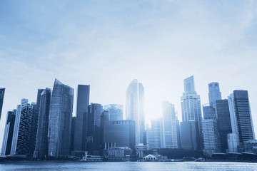 business background, beautiful abstract blue cityscape with skyscrapers and copyspace
