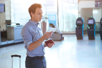 man checking boarding pass and number of gate in the airport