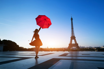 travel to Paris, silhouette of beautiful girl with red umbrella near Eiffel Tower