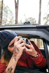 Guy Taking Pictures Outdoors Concept
