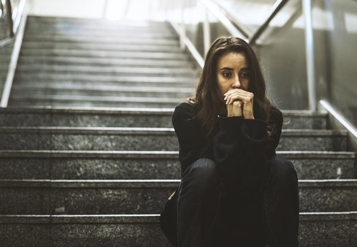 Adult Woman Sitting Look Worried on The Stairway