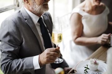 Senior Bride Hand Holding Champagne Wine Glass