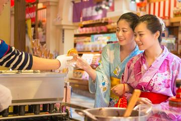 Asian girls hand of dessert during festival event