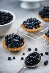 Blueberry tart pie on concrete slate