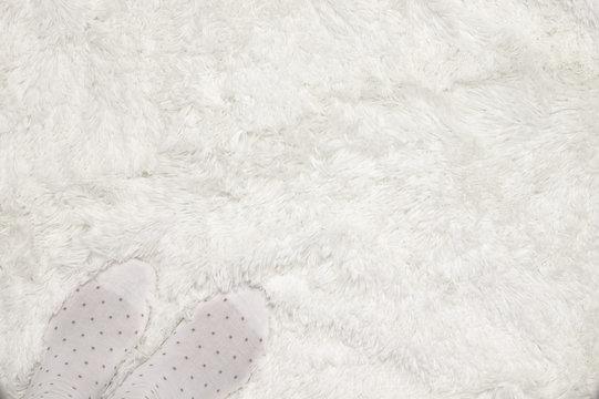 Feets on shaggy carpet