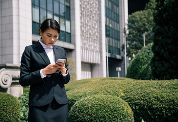 young businesswoman looking smart phone.