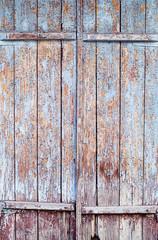 Vintage wooden door with cracked blue paint
