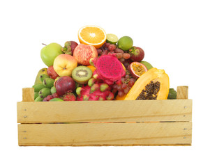 Wooden box with fruits isolated on white