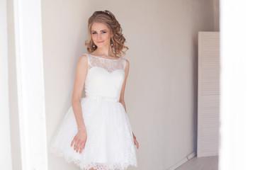 pretty girl in a short white wedding dress