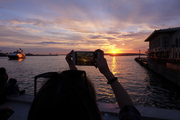 Tourist is Taking Sunset Photo with Smart Phone at The Istanbul