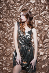 wearing glossy dress posing in the