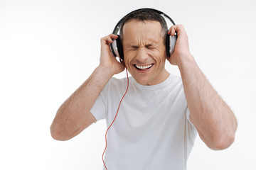Joyful male person expressing positivity