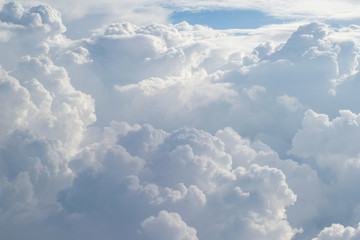Aerial view from the plane of fluffy rain cloud in daytime - Cloudscape Fototapete
