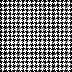 Black and white houndstooth pattern vector. Classical checkered textile design.