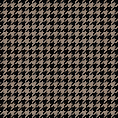 Black and gold houndstooth pattern vector. Classical checkered textile design.