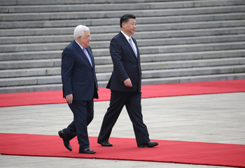 China's President Xi Jinping and Palestinian President Mahmoud Abbas attend a welcoming ceremony in Beijing
