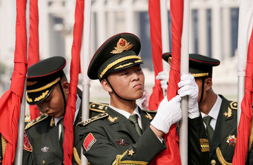 Soldiers from an honour guard prepare for a welcoming ceremony in Beijing