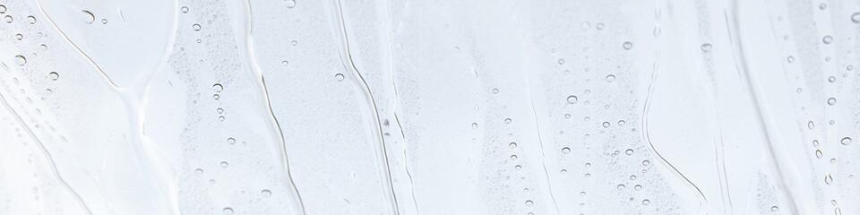 Fensterscheibe mit abperlendem Wasser als Hintergrund Fototapete