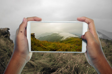 Travel concept, take photography fog and mountain by phone gallery