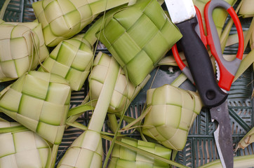 Ketupat Nasi (rice dumpling) casing in the making . Ketupat is traditional food during the Eid festive season in Malaysia