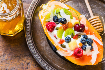 Breakfast with fruit salad in fresh papaya fruit.