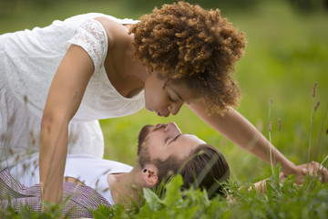 Romantic Young Couple Kissing In Countryside Together