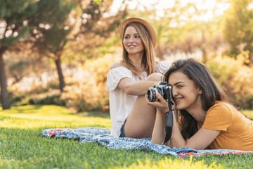 Beautiful women having fun taking any photography in the park.
