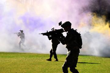 Soldier walking through smoke
