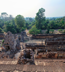 View from the top of the The Pre Rup temple and the rainforest on the horizon, Angkor Complex, Siem Reap, Cambodia. Ancient Khmer architecture, World Heritage