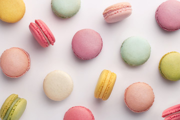 Macarons pattern on white background. Colorful french desserts. Top view