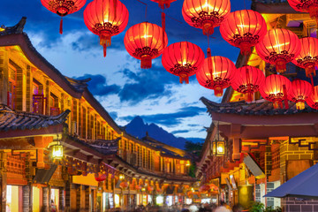 Wall Murals China Lijiang old town in the evening with crowed tourist.