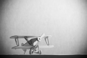 image of wooden toy airplane over wooden table. retro style image