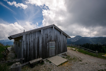 Wooden shed on green meadow in Swiss Alps