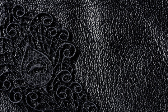 Detail of black lace on leather