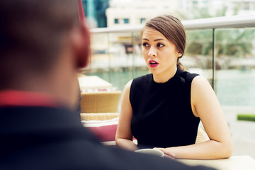 Attractive young businesswoman looking confused while making break outside office.