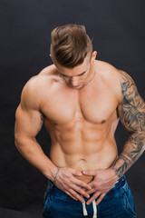 Young and healthy man topless show six pack abs
