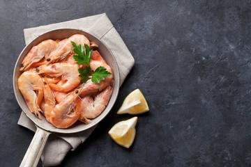 Fresh seafood on stone table. Shrimps