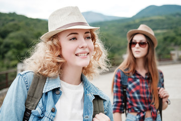 Two girls in hats traveling through ruins