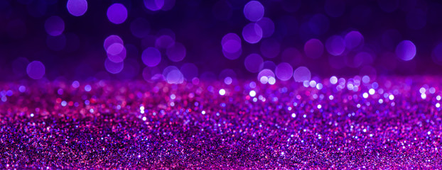 purple Sparkling Lights Festive background with texture. Abstract Christmas twinkled bright bokeh...