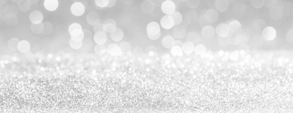 silver and white bokeh lights defocused. glitter  abstract background
