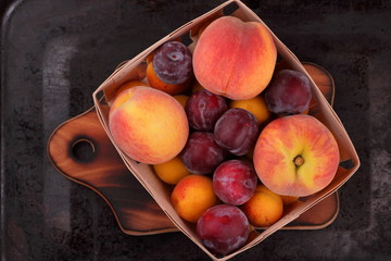 Peaches, apricots and plums in the basket