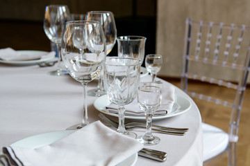 Serving a formal dining event, glasses and dishes for consumers. Cutlery for people in the restaurant.