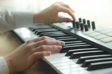 Female adjust the synthesizer