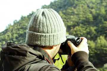 Man Is Shooting Photo At Mountain