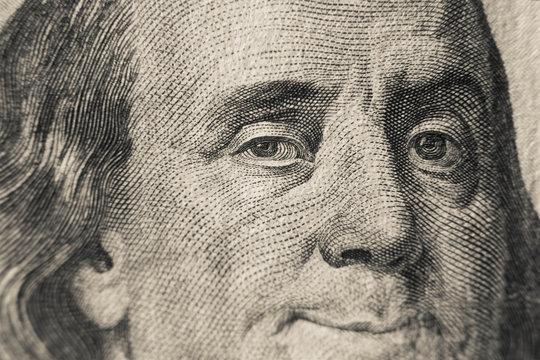 Winking Benjamin Franklin on hundred US dollars bill