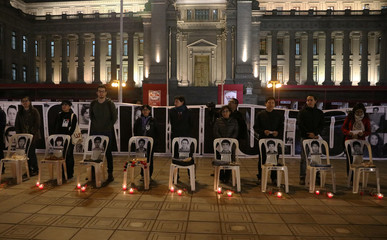 People protest against former president Alberto Fujimori during a vigil in front of Justice Palace in Lima