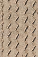 Car tire tracks on the ground