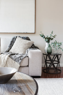 Gorgeous neutral interior of light textures and a blank wall art