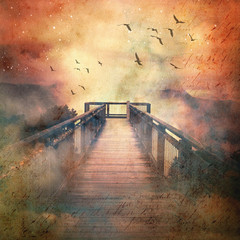 Atmospheric scene of a flock of birds and wooden bridge leading into low clouds in a surreal starry sky above misty mountains. Vintage, grunge textured image.